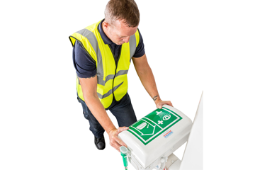 Male worker lifting eye wash lid