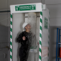 Multi-nozzle cubicle safety shower with detergent inducer and hose brush